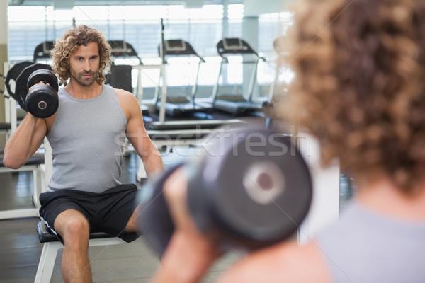 Młody człowiek siłowni refleksji młodych Zdjęcia stock © wavebreak_media