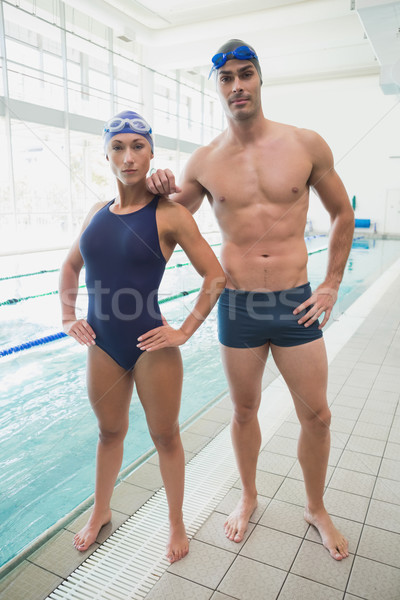 Fit couple swimmers by the pool at leisure center Stock photo © wavebreak_media