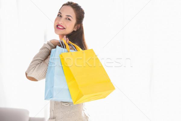 Happy brunette holding shopping bags Stock photo © wavebreak_media
