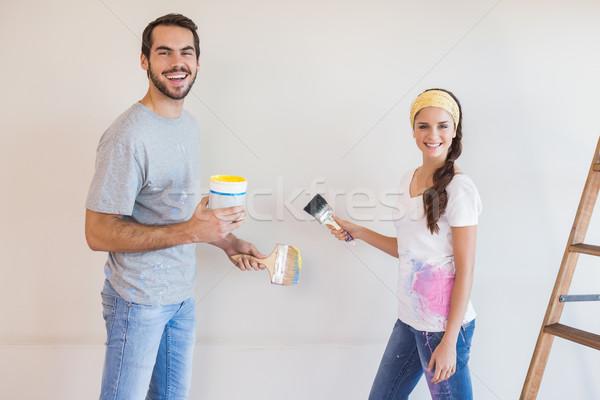 Cute couple painting the wall Stock photo © wavebreak_media