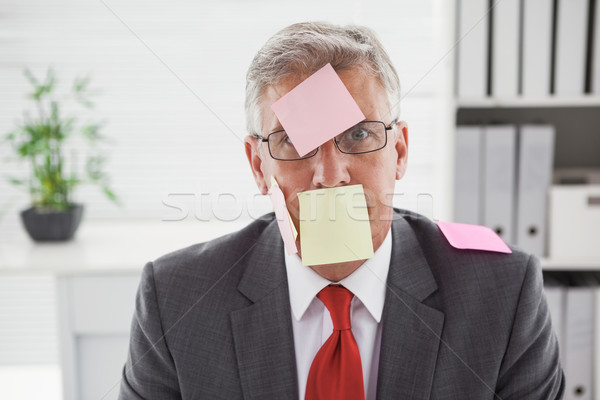 Confused businessman with sticky notes on head Stock photo © wavebreak_media