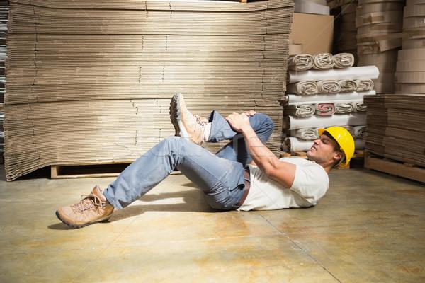 Worker lying on the floor in warehouse Stock photo © wavebreak_media