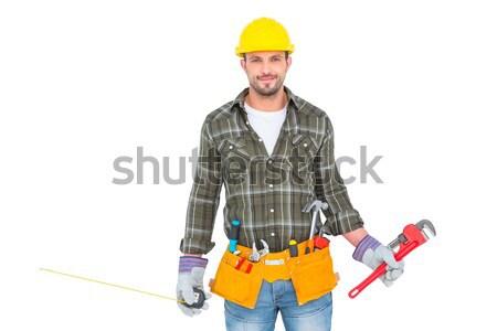 Electrician standing against white background Stock photo © wavebreak_media