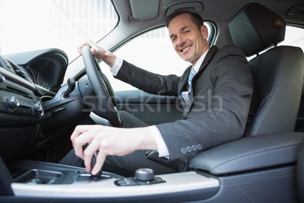 улыбаясь бизнесмен сиденье автомобилей бизнеса окна Сток-фото © wavebreak_media
