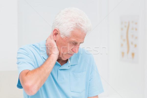 Senior man suffering from neck ache Stock photo © wavebreak_media