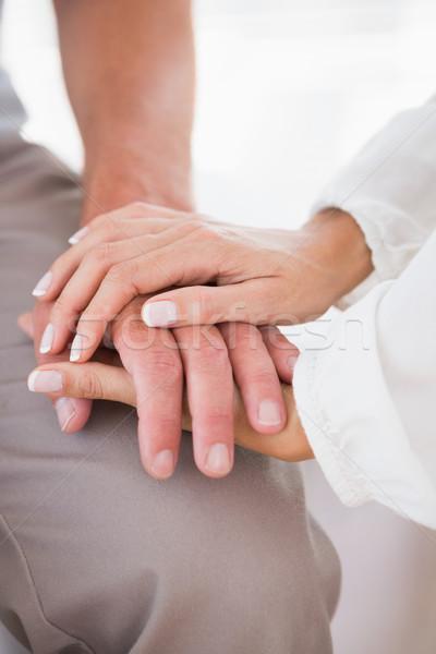 Uomo terapia medici ufficio donna mani Foto d'archivio © wavebreak_media