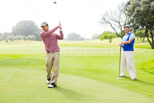 Golfista club amico dietro campo da golf sport Foto d'archivio © wavebreak_media