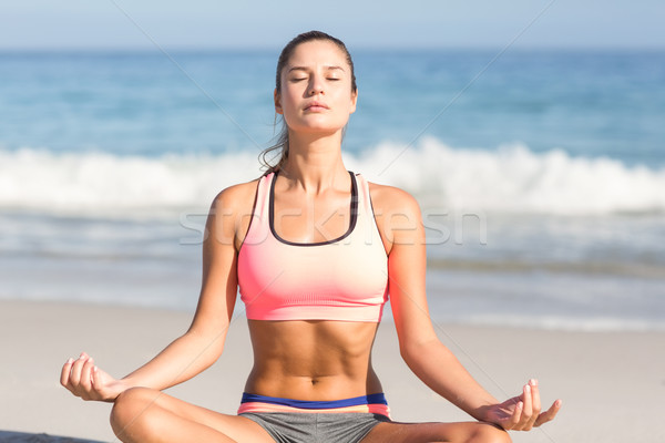 Fit woman doing yoga beside the sea  Stock photo © wavebreak_media