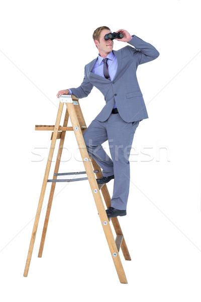 Işadamı dürbün tırmanma merdiven beyaz adam Stok fotoğraf © wavebreak_media