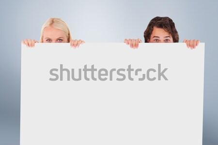 Fiatal pér rejtőzködik mögött üres tábla fehér nő Stock fotó © wavebreak_media