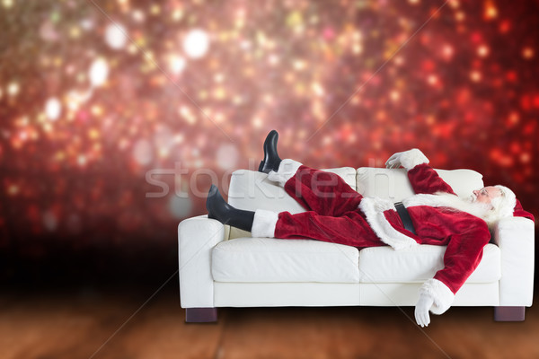 Composite image of santa claus taking a nap Stock photo © wavebreak_media