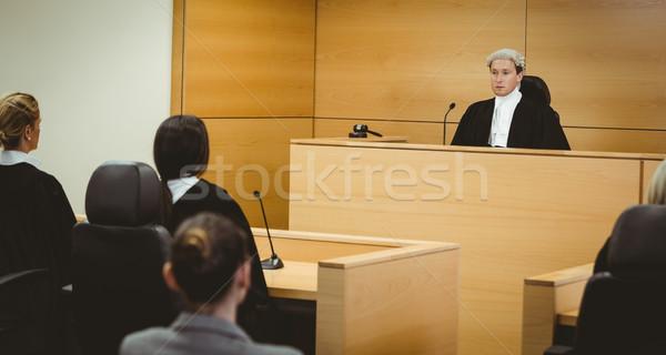 Giudice indossare parrucca bandiera americana dietro giudice Foto d'archivio © wavebreak_media