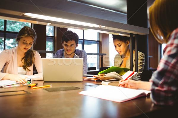 Zamyślony studentów biurko za pomocą laptopa biblioteki Zdjęcia stock © wavebreak_media
