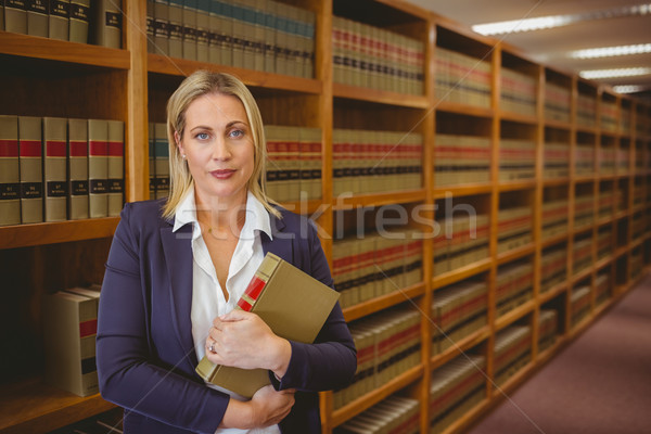 Kadın kütüphaneci poz kitap kütüphane Stok fotoğraf © wavebreak_media