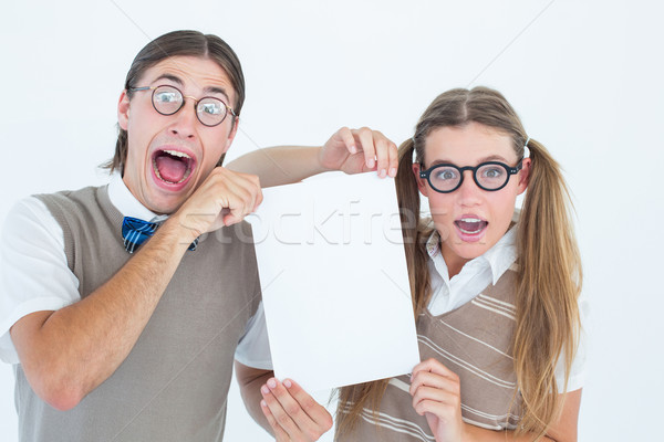Geeky hipsters holding a poster  Stock photo © wavebreak_media