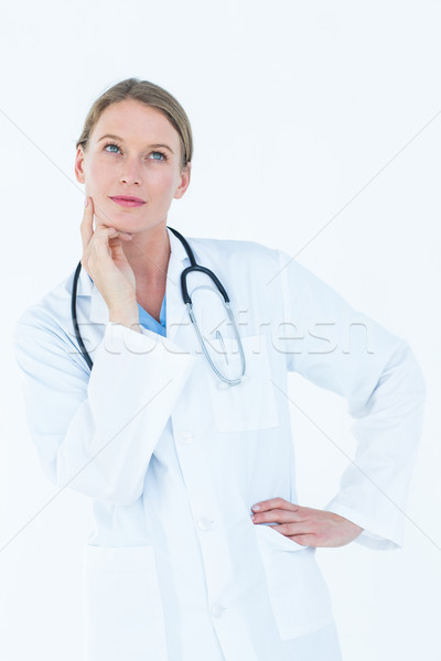 Thoughtful doctor thinking about work Stock photo © wavebreak_media