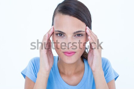 Pretty woman with headache touching her temples looking at camer Stock photo © wavebreak_media