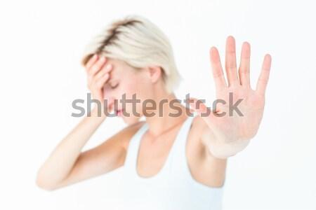 Sad blonde holding her hand  Stock photo © wavebreak_media