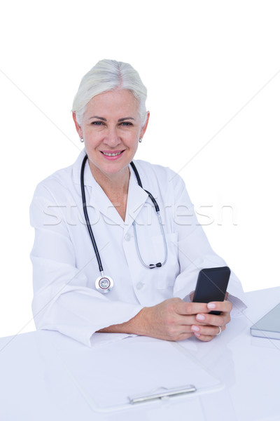 Thinking woman doctor phoning with her smartphone Stock photo © wavebreak_media