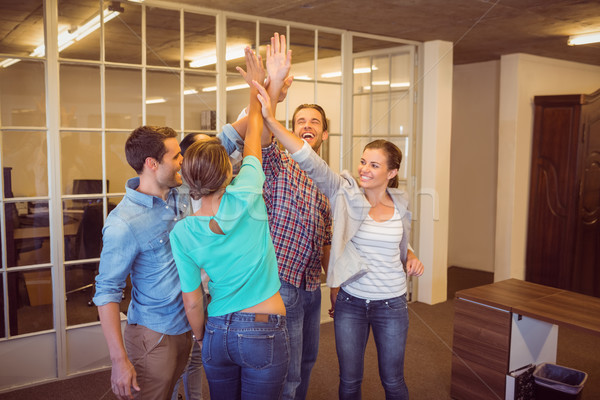 Creative business team raising their hands Stock photo © wavebreak_media