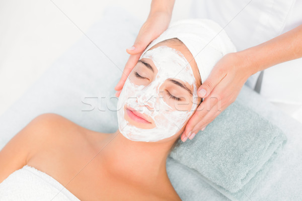 Stock photo: Attractive woman receiving treatment at spa center