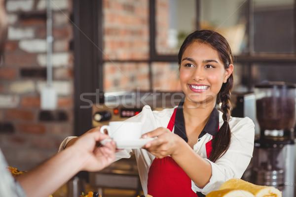 Smiling waitress serving a client Stock photo © wavebreak_media