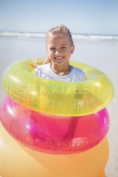 Сток-фото: портрет · девушки · Постоянный · надувной · кольцами · пляж