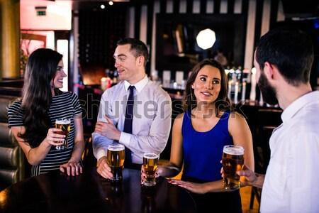 Amis high five club homme boire Photo stock © wavebreak_media