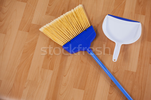 Sweeping broom and dustpan on wooden floor Stock photo © wavebreak_media