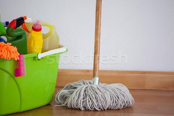 Mop and cleaning equipment on wooden floor Stock photo © wavebreak_media