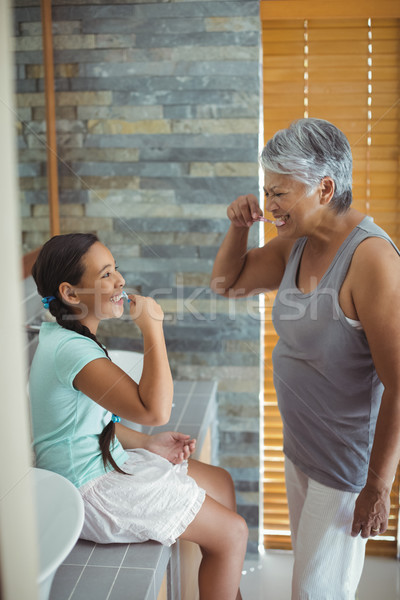 Grandmother and granddaughter brushing teeth in the bathroom Stock photo © wavebreak_media