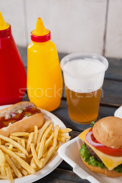 Drink and snacks on wooden table Stock photo © wavebreak_media