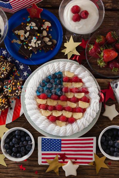 Fruitcake and various sweet foods arranged on wooden table Stock photo © wavebreak_media