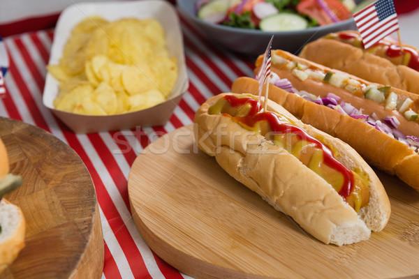 Forró kutyák fa asztal negyedike közelkép étel Stock fotó © wavebreak_media