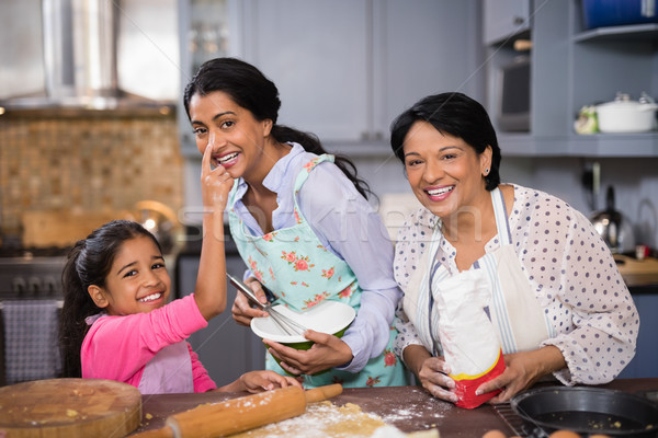 Portrait of cheerful multi-generation family preparing food together Stock photo © wavebreak_media