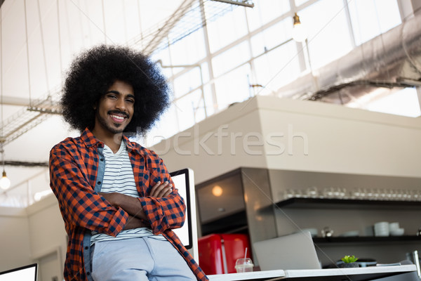 Portrait of smiling man with curly hair at office Stock photo © wavebreak_media