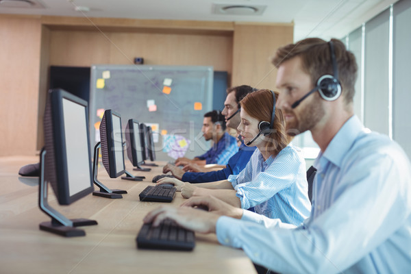 Side view of business people working at call center Stock photo © wavebreak_media
