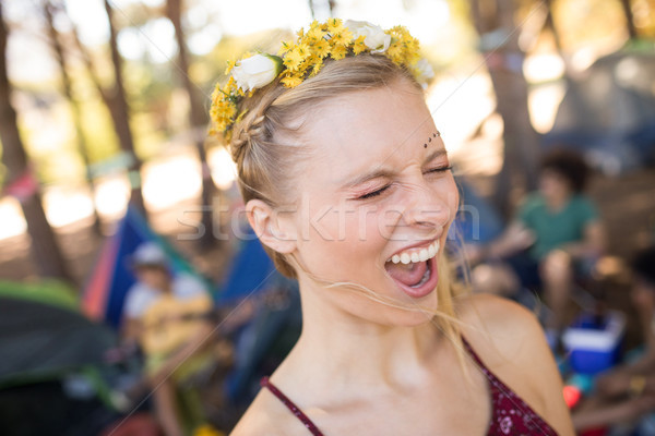 Young woman shouting with eyes closed at campsite Stock photo © wavebreak_media