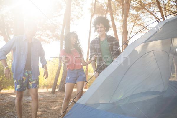 Happy friends standing by tent Stock photo © wavebreak_media