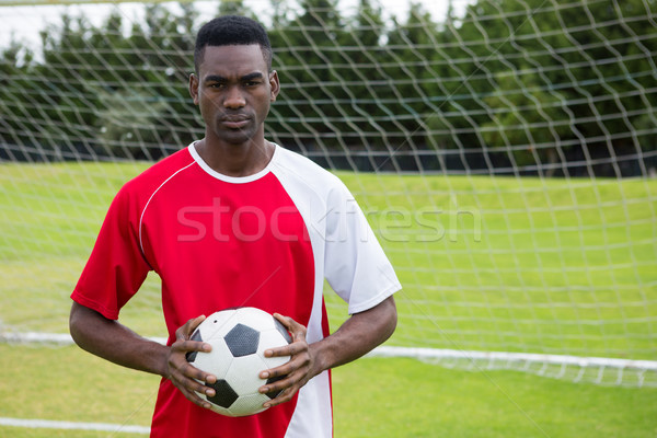 Portrait of serious confident male soccer player holding ball Stock photo © wavebreak_media