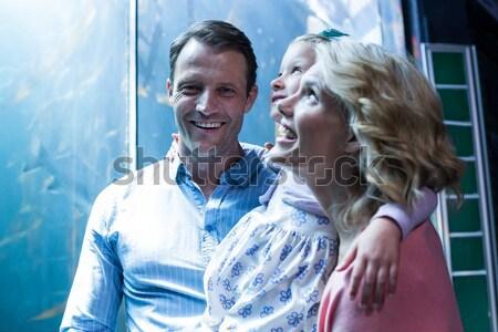 Man shielding eyes against white background Stock photo © wavebreak_media