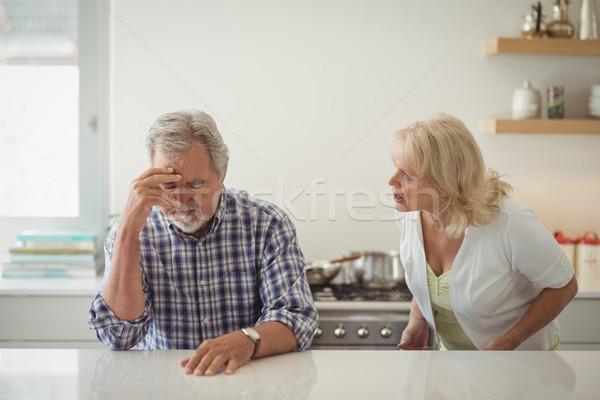 Idős pár veszekedik konyha otthon nő kávé Stock fotó © wavebreak_media