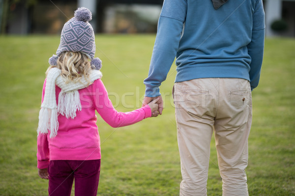 Father and daughter holding hands in the garden Stock photo © wavebreak_media