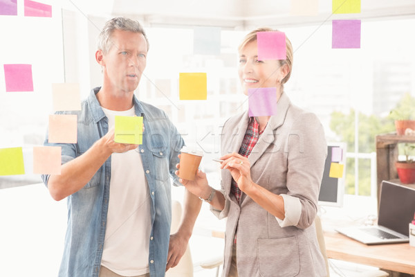 Casual business colleagues working with sticky notes Stock photo © wavebreak_media