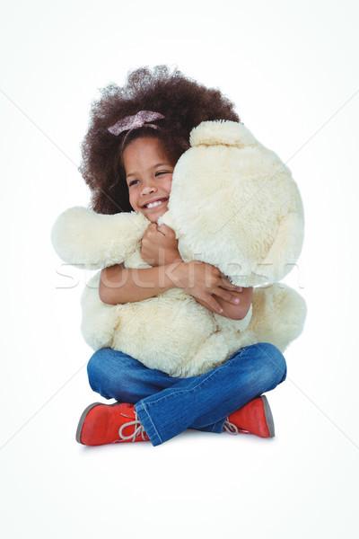 Cute girl sitting on the floor hugging teddy bear Stock photo © wavebreak_media