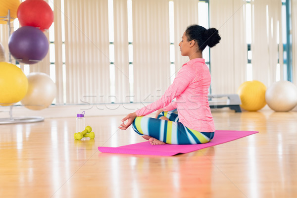 Woman performing yoga in the gym Stock photo © wavebreak_media