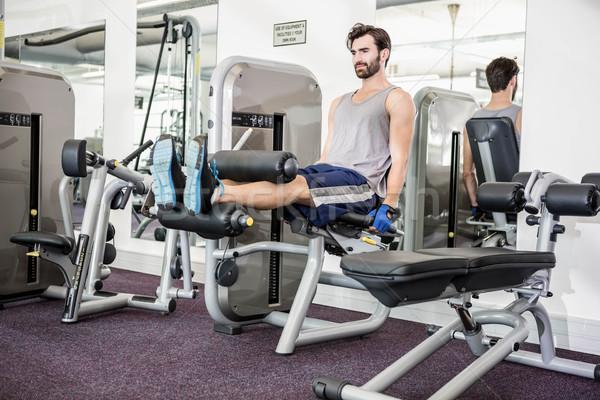 Focused man using weights machine for legs Stock photo © wavebreak_media