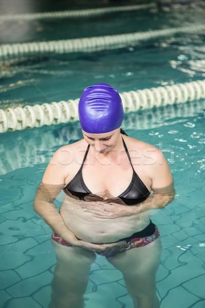 беременная женщина Постоянный бассейна прикасаться живота отдыха Сток-фото © wavebreak_media