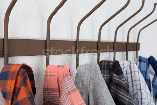 Close-up of various shirts hanging on hook Stock photo © wavebreak_media