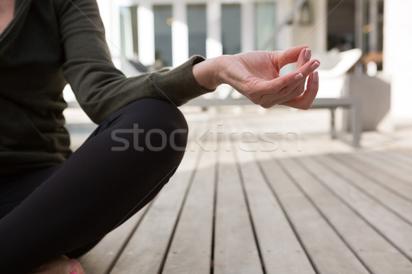Mid section of woman practicing yoga in porch Stock photo © wavebreak_media